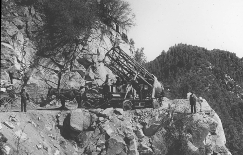 Metal_tube_of_the_60inch_telescope_being_transported_along_a_road_on_Mount_Wilson-e1488552795642